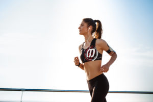 Picture of young beautiful fitness girl running